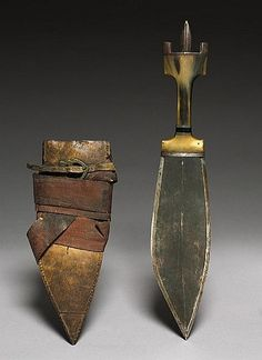 Dated: circa 1800 Place of Origin: Africa Medium: steel with horn handle Measurements: Blade - l:23.50 cm (l:9 1/4 inches). Scabbard - w:10.20 l:25.70 cm (w:4 l:10 1/16 inches). Knife including handle - l:40.70 cm (l:16 inches)