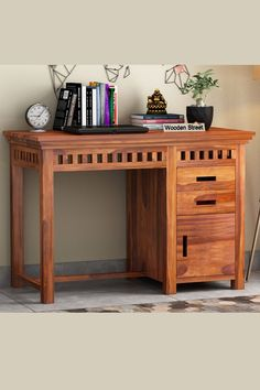 Known with spaciousness and more storage, the Adolph study table is said to be extremely stylish for the modern-day interior with the sleek pattern and slots at spaces made with Sheesham wood, which is very durable. #studytable #moderndesign #furniture