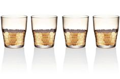 Paillette double old-fashioned glasses by Kim Seybert, available in gold (shown) or platinum, $472 for a set of four; kimseybert.com.