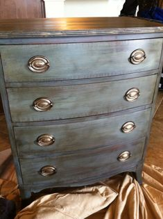 ANNIE SLOAN CHALK PAINT CHATEAU GREY OVER GRAPHITE , DARK WAX ON TOP. HARDWARE HANDLES FRESHENED UP WITH GOLD GILDING WAX.