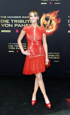 """Jennifer Lawrences Style File. The """"Hunger Games"""" star chose a fiery red outfit with matching heels for the Berlin premiere of the movie on March 16, 2012 in Germany."""