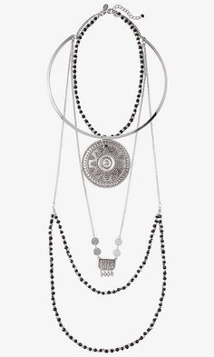 A signature necklace, marked by a large filigree pendant and layered beaded chains. It's nighttime-perfect over a metallic sweater, or an easy way to turn a t-shirt up to dressy.