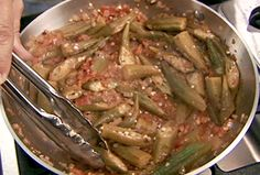 Okra and Tomatoes from FoodNetwork.com I subbed 1/4tsp cinnamon and 1/4 tsp nutmeg for cardamom, used blk pepper.  So good!