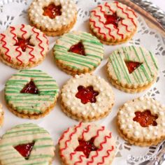 Linzer cookie cutters with mini cutout shapes make these soooo fun & easy to make. Our fave for cookie exchange parties. Click for the mouthwatering recipe!