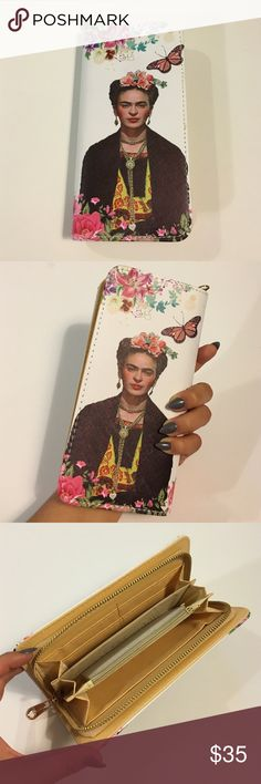 Frida Kahlo White Floral Print Portrait Wallet Stunning white floral print Frida Kahlo portrait wallet with a beautiful gold zipper in excellent brand new with tags condition. No damage. Approximately 8X4.5in. chic, unique, and gorgeous! Cotton Jangle Boutique Bags Wallets