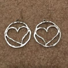 Buckle Heart Earrings Silver distressed heart earrings from buckle, worn once and in same condition as purchased Buckle Jewelry Earrings