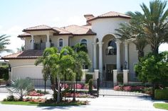This two story mediterranean waterfront home has five Bedroom, four and a half bathroom plus a Cabana and two car Garage with additional storage area. Mediterranean Homes Exterior, Mediterranean House Plans, Mediterranean Decor, Exterior Homes, Tuscan Homes, Mediterranean Architecture, Exterior Design, Coastal House Plans, Luxury House Plans