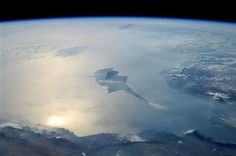 Incredible Photos from Space: Cyprus Beautiful reflection of sunlight on the eastern Mediterranean Sea. No borders or conflict visible from space…just breath-taking beauty like this view of the island of Cyprus (6-21-2010). NASA, Astronaut Wheelock