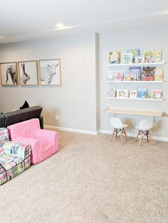 basement playroom with animal photos and book wall Under Stairs Playhouse, Simple Playhouse, Playhouse Kits, Backyard Playhouse, Build A Playhouse, Wooden Playhouse, Outdoor Playhouses, Home Daycare, Daycare Ideas
