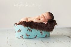 add fabric to a galvanized tub and use for baby's pictures and then to stock toys/diapers/anything in their nursery :)