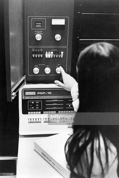 A woman adjusting an Applied Logic Corporation (AL/COM) time sharing AL-10 computer system, which consists of two Digital Equipment Corporation (DEC) PDP-10 central processing units linked together, Princeton, New Jersey, 1969.
