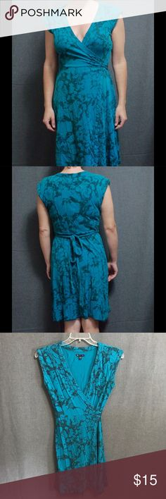 """GAP Teal Flower Wrap dress GAP teal with flower print wrap dress perfect for hot summer days!  Slight fading from wash but still in good condition. Size Medium. Measure laying flat; length from shoulder to hem 35"""" About knee length. Cotton and modal. GAP Dresses Midi"""