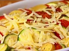 Vegetable Tian recipe from Ina Garten via Food Network // like a layered ratatouille. Review suggestions say to cook for 30 min covered and poke holes in the aluminum foil, then only 15 min covered.