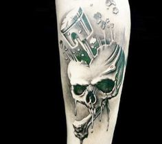 Perfect black ad grey Realistic tattoo of Skull with Piston motive done by artist Demon Tattoo