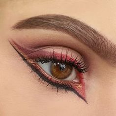 Get into her insane eye game. Keep a cotton swab and makeup remover close by to clean up the lines. | Colorful Graphic Eyeliner Is The Way To Take Your Look To New Levels