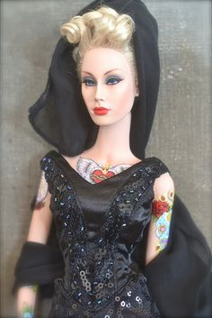 "Untitled | Flickr - Photo Sharing!                                                      I had to look this doll up, she is not Barbie, but this one is pretty.  They are called ""Sybarites"" , more like Adult Barbies, Not for children Barbies I would think.   I like the tattoos, but there is a Barbie with tattoos also."