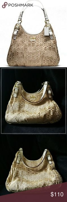 "Coach Madison Maggie Gathered Gold/White Coach Madison Maggie hobo (18886) in gathered gold fabric with white trim.  Barely used, near-flawless condition!   Clean purple interior, no marks, pulls, or snags.  Center zip with two magnetic snap sides. Gold tone hardware.   Used once & it's just sitting in my closet taking up space!  This bag deserves to be loved. 💜  H: 12"" W: 13"" D: 4"" Drop: 10""  Dustbag not included. Please ask questions if you have them!!   🚫 No trades 🚫 Coach Bags Hobos"
