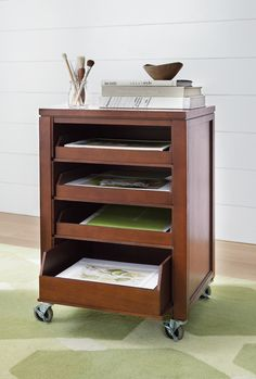 This cart with pull-out trays makes it easy to store craft supplies. HomeDecorators.com