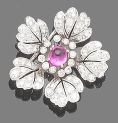 A ruby and diamond brooch  The flowerhead millegrain-set throughout with brilliant-cut diamonds, to a cabochon ruby stamen, diamonds approx. 2.05ct. total, length 3.0cm.
