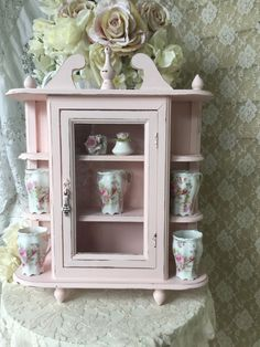 A personal favorite from my Etsy shop https://www.etsy.com/listing/247598926/shabby-pink-curio-cabinet-with-glass