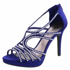 """Get noticed in the Klubbin Sandal from Fioni Night! It features a satin upper with loads of rhinestone embellishments, zippered ankle cage, padded insole, 4"""" heel and a near 1"""" platform, and a sturdy outsole. Manmade materials."""