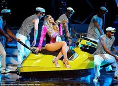 Mariah Carey stuns in number of outfits as she thrills the crowd in Las Vegas   The 46-year-old showed off her slimmed-down figure in a number of plunging looks during a show at The Colosseum at Caesar's Palace Las Vegas. In true diva fashion she arrived the stage in a pink convertible and a yellow jet ski. More photos after the cut...  Fashion