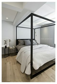 FourOnC Cape Town. Interiors by Del Fante Design Black oak minimalist Four poster bed with brass accents and charcoal distressed linen