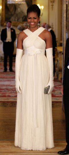 Michelle Obama in Tom Ford at Buckingham Palace. Love the dress, not so much the gloves. But Mrs. Obama always dresses well.