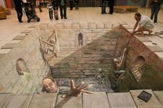 Out of the dungeon chalk art - I like how it looks like the real person on the right is pulling one guy up