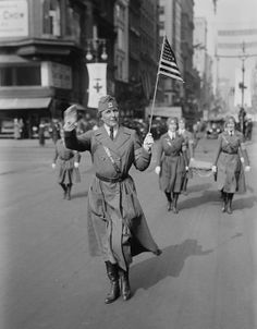 Daisy Harriman (1870-1967), parading in New York, wearing a Red Cross uniform. During the World War I, she organized the American Red Cross Women's Motor Corps and directed them in France. Ca. 1917-18.