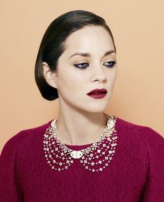 """Marion Cotillard wearing a Louis Vuitton """"Voyage dans le Temps"""" white-gold and diamond necklace."""