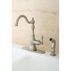 @Overstock - Update your kitchen decor with this American Classic swivel kitchen faucet. This high-spout faucet features a satin nickel finish and a matching hand-held side spray. http://www.overstock.com/Home-Garden/American-Classic-Satin-Nickel-Single-handle-Kitchen-Faucet/5267264/product.html?CID=214117 $111.99