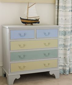 Chest Of Drawers painted by Annie Sloan using Paris Grey on the main part of the chest, with Louis Blue, Versailles and Duck Egg Blue on the drawers.  For Paint Transformations by Annie Sloan, published by Cico Books, photographs by Christopher Drake.