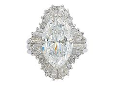 A Diamond and Platinum Ballerina Ring Set with a marquise-cut diamond weighing 5.10 carats, within an undulating surround of baguette-cut diamonds, mounted in platinum