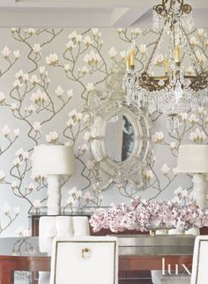 Making quite the statement as you round the bend from the entry, the Magnolia Grey Lustre wallcovering by Cole & Son from Lee Jofa sets a festive tone in the dining room, which is magnified by the crystal chandelier from Corbett Lighting.