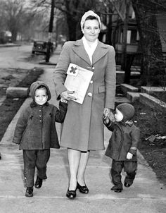 Mrs. Irene Geiger and her children campaign for the Douglas County Red Cross Fund to help in the war effort on March 21, 1944. THE WORLD-HERALD