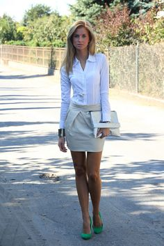 Love her outfit, including the cute green shoes. Perfect little skirt for work too!