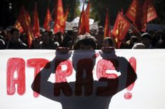 MARCH IN MADRID: Protesters marched against government austerity measures in Madrid on Saturday. (Andres Kudacki/Associated Press)