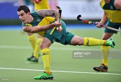Australia's Kieran Govers shoots during a men's preliminary field hockey match between South Africa and Australia at the Glasgow National Hockey Centre at the 2014 Commonwealth Games in Glasgow, Scotland, on July Commonwealth Games, Glasgow Scotland, Gesture Drawing, Garra, July 28, Field Hockey, World Of Sports, Hockey Players, Ice Hockey