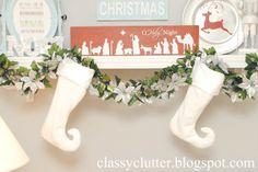Nativity Vinyl on wooden board via Classy Clutter