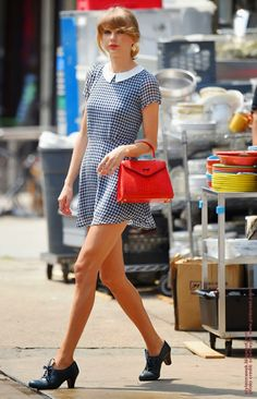 #Celebrity #Street #Style - Taylor Swift Girly Twist On a Classic Blue and White Checkered Dress.  Taylor Swift has never met a preppy print she didn't love. She puts a girly twist on a classic blue-and-white checkered dress with a flirty hemline and Peter Pan collar.