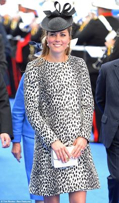 Looking good! Kate rocked the £169 High Street mac, accessorising with a Jane Taylor statement hat on her last royal engagement before her baby arrives