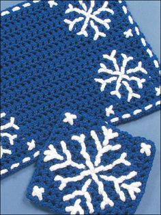 Winter Snowflakes Place Mat: Crochet 'n' Weave a winter wonderland using worsted weight yarn. Skill Level: Easy