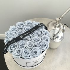 Fleur du Luxe preserved blue grey roses from Ecuador in our signature hat box…