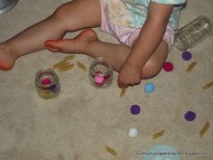Empty jars, pompoms and pasta....great fine motor fun for toddlers!