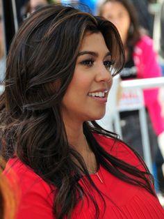 Try Kourtney Kardashian's subtle highlights for an easy summer look.