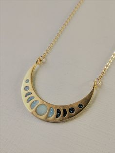 """""""Mystical Moon Phases"""" Brass and Resin Necklace """"Mystical Moon Phases"""" Brass and Resin Necklace,Moon Phase Art """"Mystical Moon Phases"""" Brass and Resin Necklace – Muro Jewelry Related posts:Basil Mozzarella Grilled Cheese Recipe - Healthy. Resin Necklace, Washer Necklace, Gold Necklace, Moon Phases Art, Metallic Paint, Beautiful Necklaces, Mystic, Brass, Jewels"""