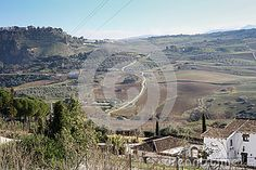 Photo about A view upon Ronda fields taken in december 2015 around Christmas time. It s a MUST-VISIT place if you like to hike! Image of fields, europe, evening - 70321444 Andalusia Spain, Christmas Time, Fields, Grand Canyon, City Photo, December, Hiking, Europe, Stock Photos