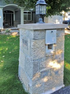 The combination of Buechel Stone's Fond du Lac Castle Rock with siding makes for beautiful curb appeal. Even the mailbox features Fond du Lac Castle Rock with an Indiana Cut Stone cap. Visit www.buechelstone.com/shoppingcart/products/Fond-du-Lac-Ca... for more information.