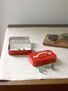 Retool a tin container with handles and red paint and you have a container for cuff links, perfect for dad.